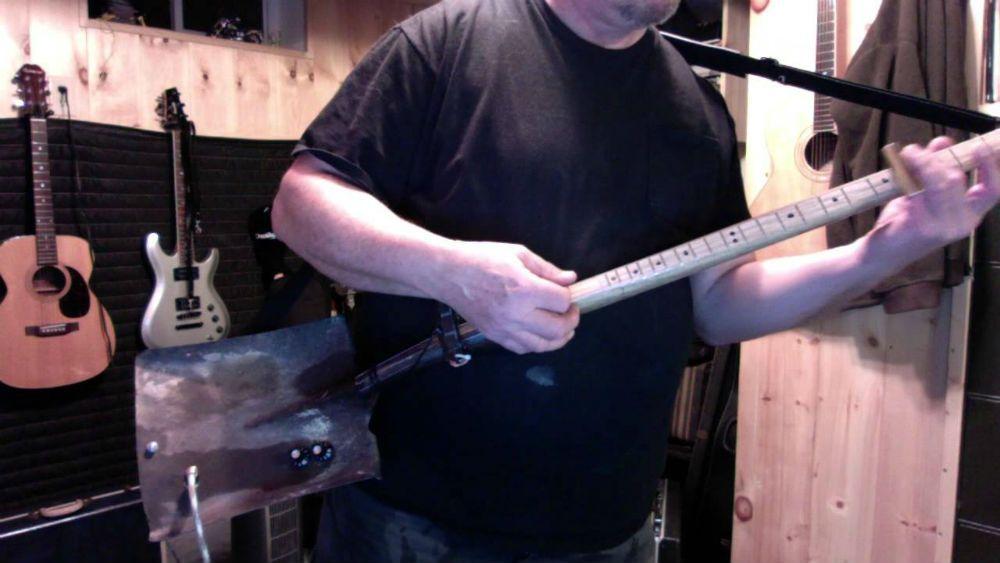man uses shovel for electric guitar. Black Bedroom Furniture Sets. Home Design Ideas