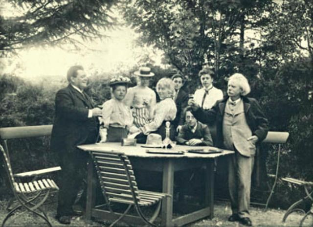 A rare surviving photograph of the Brodskys' visit in the summer of 1906 to Grieg's family home in Troldhaugen, near Bergen. From left to right the figures standing in the foreground are: Adolph Brodsky, his wife Anna, Nina Hagerup Grieg, and Edvard Grieg