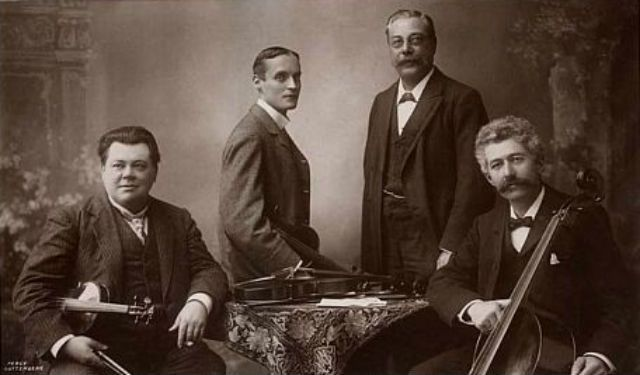 The Brodsky Quartet, active from 1895 until circa 1918, of Manchester, England, led by Dr Adolph Brodsky (1851-1929), with Christopher Rawdon Briggs (1869-1948), Simon Speelman (1852-1920) and Carl Fuchs (1865-1951). (photo: Percy Guttenberg, Manchester, circa 1907, postcard published by the Rotary Photographic Co Ltd)