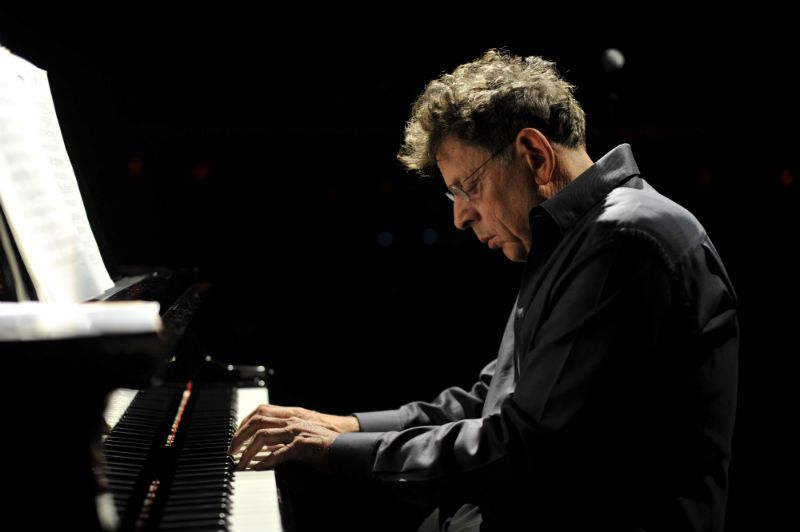 Composer Philip Glass playing piano photo by fernando aceves