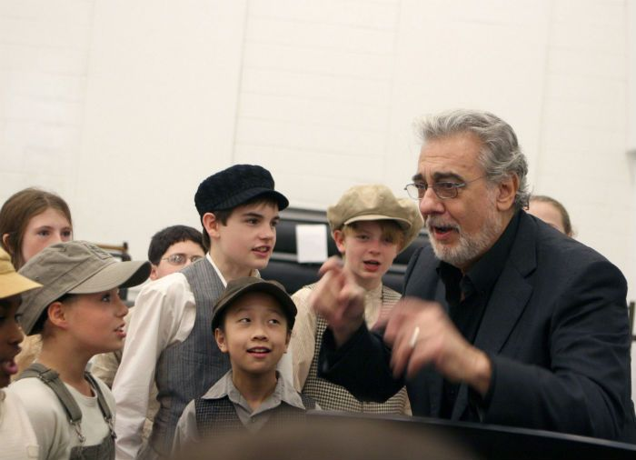 Placido Domingo working with the children in the cast of Carmen (2008)