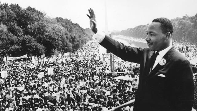 Photo: Martin Luther King waves to the crowds at the March on Washington for Jobs and Freedom, 28 August 1963. (Getty Images)