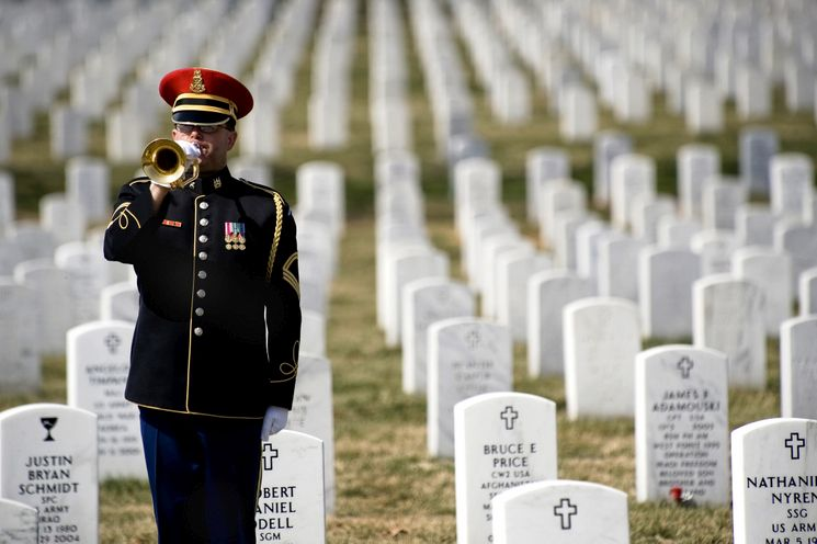 A lone U.S. Army bugler plays Taps at the conclusion of the First Annual Remembrance Ceremony in Dedication to Fallen Military Medical Personnel at Arlington National Cemetery, March 11, 2009.(DoD photo by Mass Communication Specialist 1st Class Chad J. McNeeley/Released)