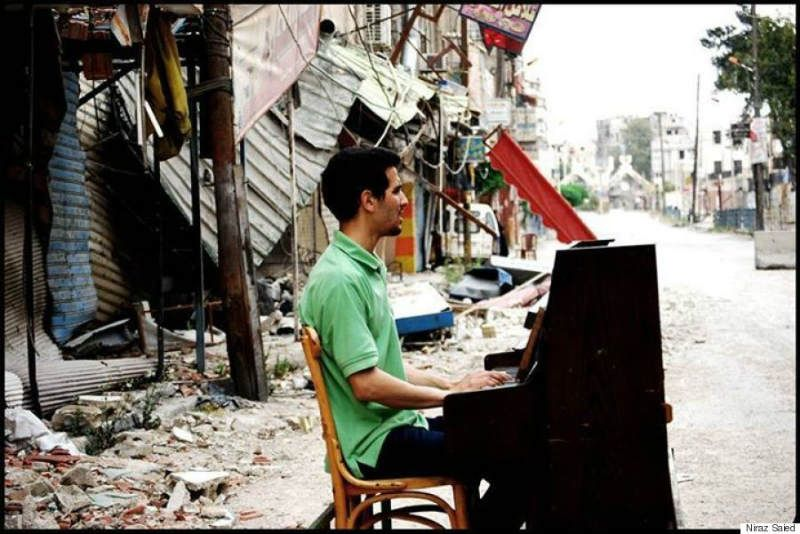 Ayham Ahmad continues to play the piano in spite of the challenges the civil war has put in his way.