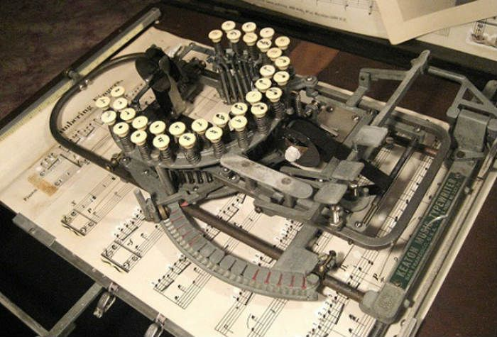 The Keaton Music Typewriter was first patented in 1936 (14 keys) (view 1936 patent) by Robert H. Keaton from San Francisco, California.