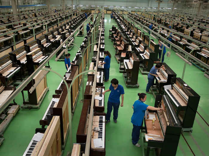 In China, one factory makes a piano a minute to keep up with demand created by 40 million children studying to play. Photo: Jeremy Sutton-Hibbert/The Guardian