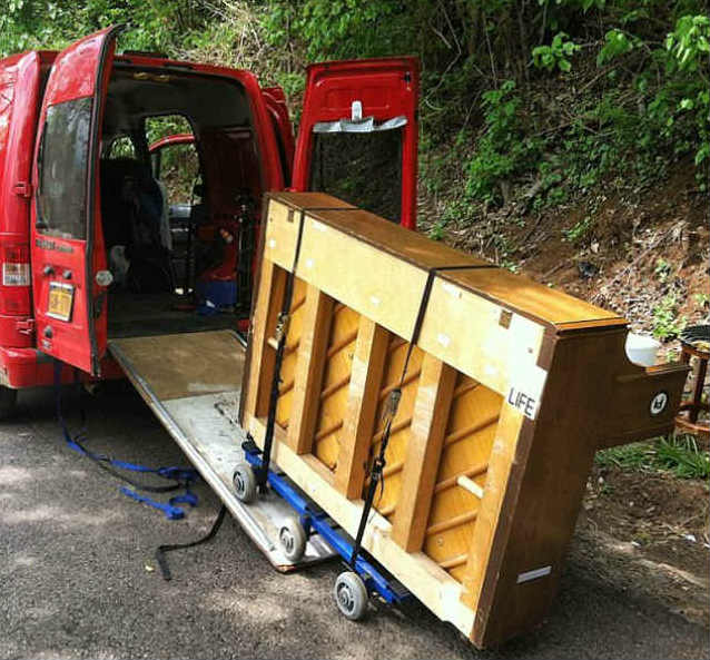 Dotan Negrin transports his piano in a van