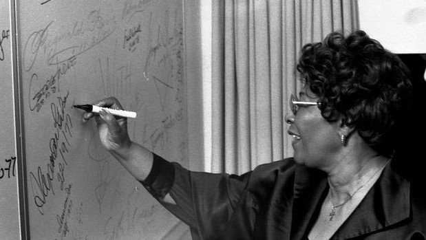 Ella Fitzgerald signs her name at the Opera House. Photo: supplied