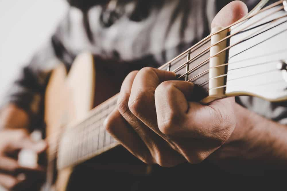 learn guitar chords and progression lessons online